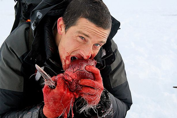 Bear-Grylls-eating-a-reindeer-heart